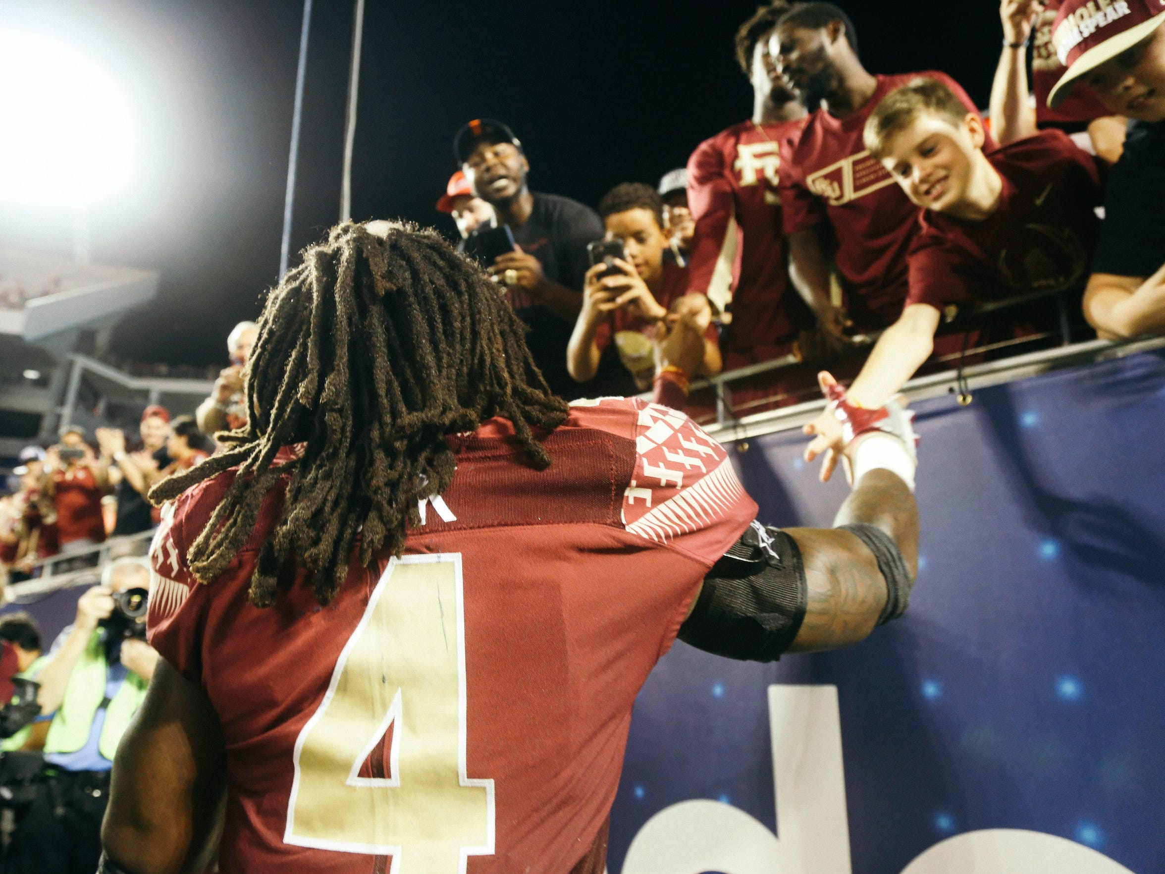 Dalvin Cook celebrates with fans after FSU's 45-34 win over Ole Miss. The Seminoles outscored the Rebels 32-6 in the second half.