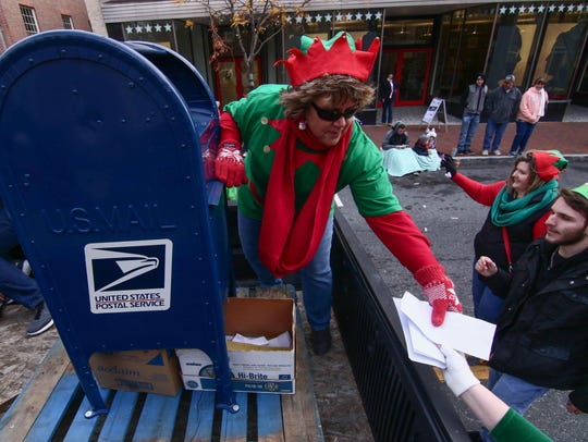 Santa helpers gathers letters from children during