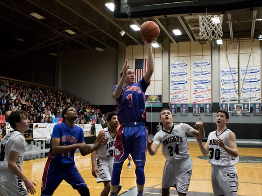 Las Cruces High's Alonso Johnson gets a jump shot over Oñate Knight defenders in boys prep basketball game on Friday.