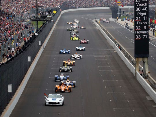 Fernando Alonso leads the field around Indianapolis