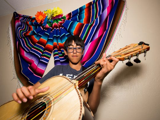 Thirteen-year-old Cesar Sandoval keeps the rhythm on