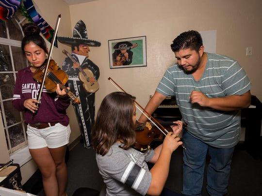 Music instructor Santiago Rodriguez keeps a watchful