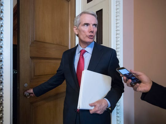 Sen. Rob Portman pauses for a reporter's question as