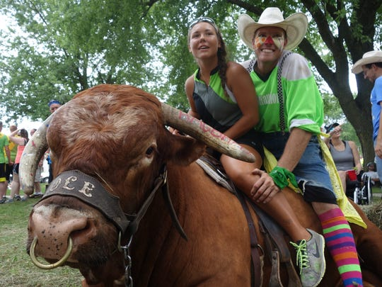 """Maggie Weber, of Waterloo and rodeo clown Jason """"whistle-nut""""Dent pose for a photo on Ole the in Humeston Wednesday, July 27, 2016."""