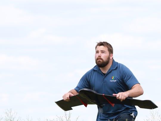 Joe Paul of FlightSight prepares to launch at drone