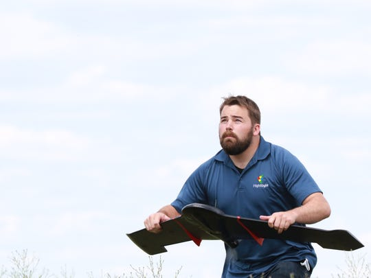 Joe Paul of FlightSight prepares to launch at drone at Wallendal Farms in Grand Marsh on June 27. The combination of aviation and farming keeps involved in the state's agricultural sector.