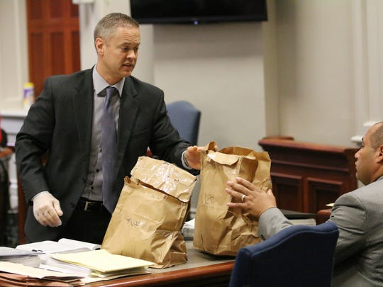 Ross County Prosecutor Matthew Schmidt handles evidence during Jason McCrary's murder trial in July of 2016.