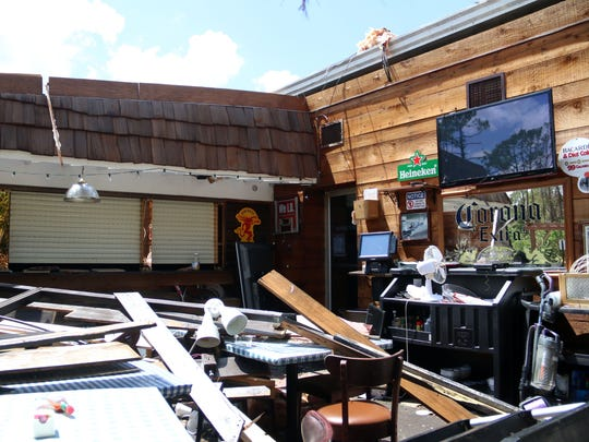The back patio and bar area of Cracklin' Jack's, a Naples business, sustained major damage from Hurricane Irma.