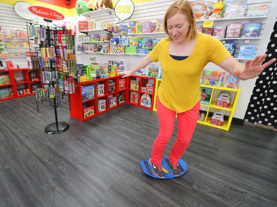 Sarah Fowles tries a Spooner board to help children