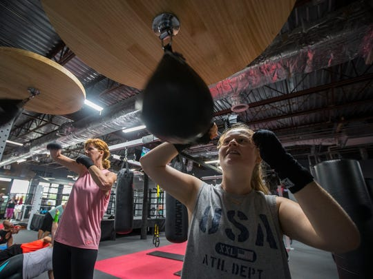 Heather McFalls works with the speed bag Tuesday morning at Omni Fight Club in Cape Coral as part of her group workout. The club offers fitness kickboxing, strength training and a cardio conditioning workout.
