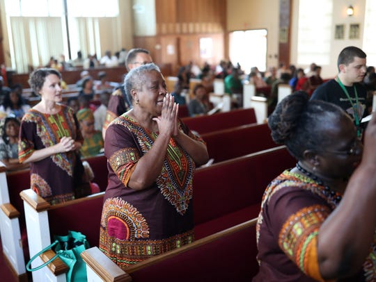 Carole Curry sings with the choir during service on