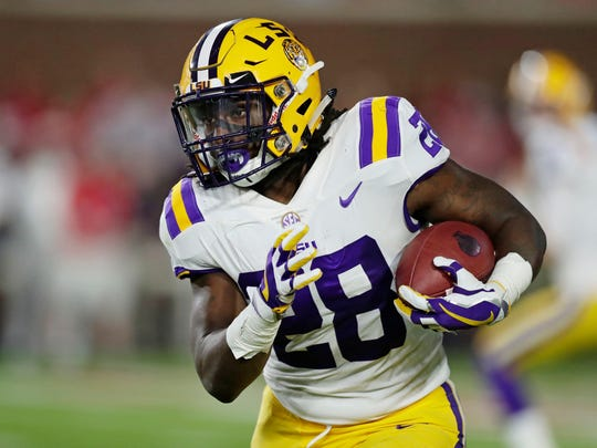 LSU running back Darrel Williams (28) runs upfield