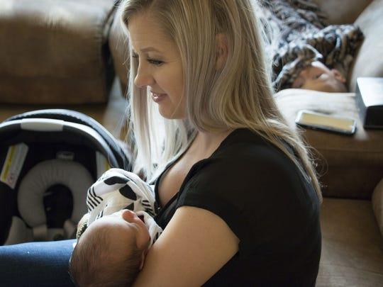 Shannon Geise holds her newborn son, Sebastian, while