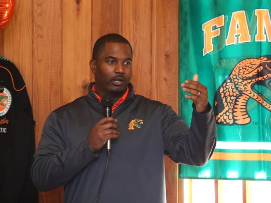 Willie Simmons made his first appearance at the 220 Quarterback Club on Wednesday. FAMU's new head coach was presented with a FAMU jacket and an orange and green tie.