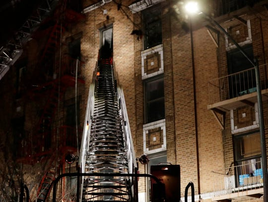 Firefighters respond to a deadly fire Thursday, Dec.