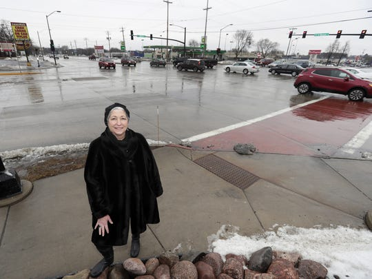 Leah Weycker, director of the Military Avenue BID, stands at the southeast corner of Mason Street and Military Avenue on Jan. 11 in Green Bay. The six-lane intersection is the heart of the Military Avenue shopping district on the west side of Green Bay.