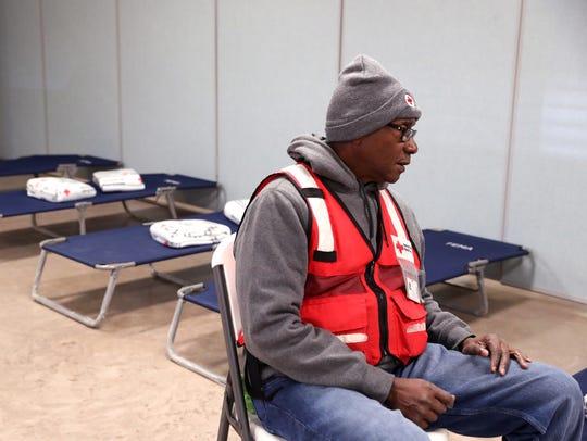 American Red Cross volunteer Milton Bradford waits