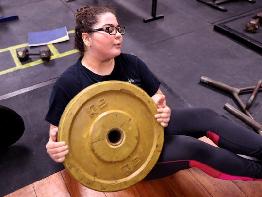 Moody High School wrestler Kacie Rodriguez works out