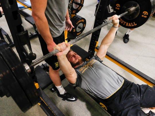 On the bench press, Iowa safety Jake Gervase takes