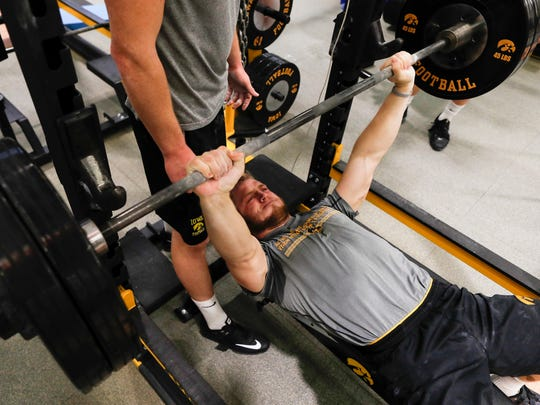 On the bench press, Iowa safety Jake Gervase takes part in the winter strength and conditioning program on Feb. 20.