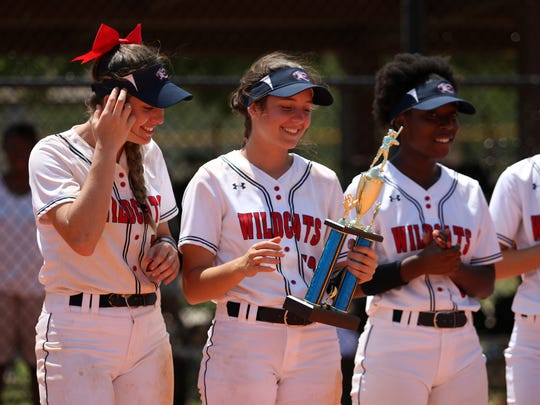 Estero High School players accept the first place trophy after defeating Bishop Verot, 7-1, in the championship game of the 22nd annual Bill Longshore Memorial Softball Tournament last year.