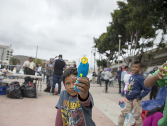 Central American migrant children camped outside the