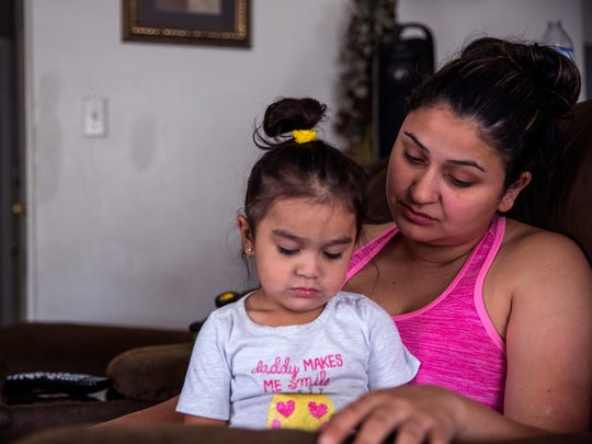 """Savanna Rodriguez sits with her daughter Erabella Rodriguez, 2, in their apartment at the Rincon Point Apartments on Monday, May 21, 2018. """"I'm very shocked, sad. I'm real hurt because I have two young kids so it's hard to just up and go somewhere else."""""""