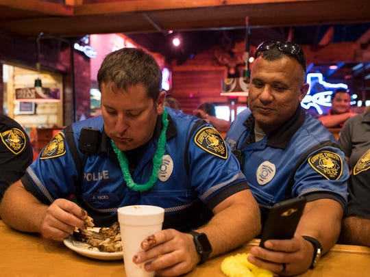Senior Officer Jason Wicks eats ribs for the Corpus Christi Police Department's team during the 5th Annual Rib-Eating Contest on Wednesday, June 6, 2018, at Texas Roadhouse.
