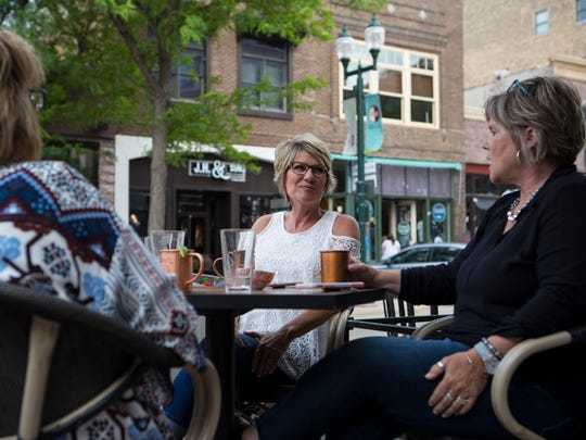 Brenda Veurink (left), Cyndee Vanderpol and Lisa Spoelstra get drinks at Carpenter Bar in downtown Sioux Falls, S.D. Wednesday, June 6, 2018.