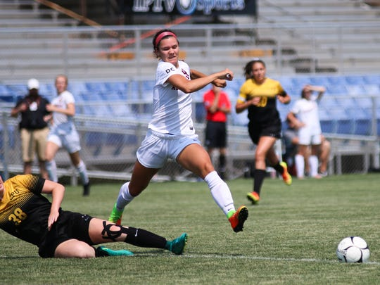 Davenport Assumption's Carly King (9) chases after the ball as Center Point-Urbana's Raegan Dufoe slides for it during the girls' Class 1A state soccer semifinals at the Cownie Soccer Complex in Des Moines on June 8, 2018. Assumption beat Center Point-Urbana 5-1 to advance to the finals.