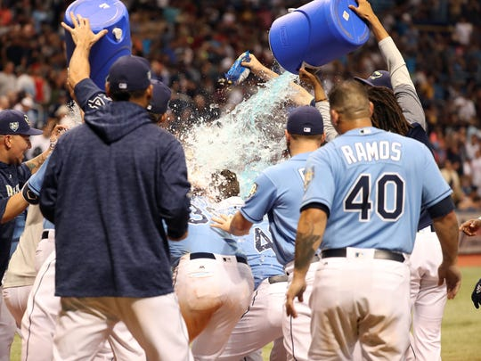 Tampa Bay Rays first baseman Jake Bauers (9) gets a Gatorade bath at home plate.