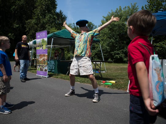 Michael Hoffman of the Juggling Hoffmans performs for