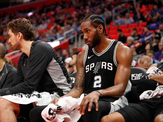 San Antonio Spurs forward Kawhi Leonard (2) sits on