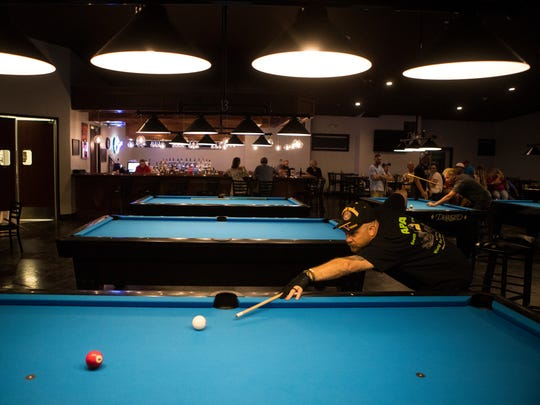Keith Mapps plays pool at the Slate Cafe in Smyrna on Monday, July 16, 2018. Mapps, who has only been playing pool for two years, will travel to Las Vegas for the American Poolplayers Association World Pool Championships at the Westgate Las Vegas Resort & Casino in August.