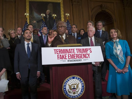 House Majority Whip James Clyburn of S.C., speaks accompanied by Rep. Madeleine Dean, D-Pa., left, Rep. Joaquin Castro, D-Texas, House Majority Leader Steny Hoyer of Md., House Speaker Nancy Pelosi of Calif., right, and others, during a media availability about a resolution to block President Donald Trump's emergency border security declaration on Capitol Hill, Feb. 25, 2019, in Washington.