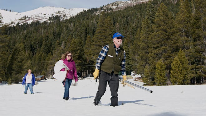Frank Gehrke, right, chief of the California Cooperative Snow Surveys Program, for the Department of Water Resources, crosses a snow covered meadow as he conducts the second snow survey of the season Thursday, Feb. 1, 2018, near Echo Summit, Calif. AccuWeather's spring forecast says much of the northern U.S. will endure rounds of cold and snow into March and April.