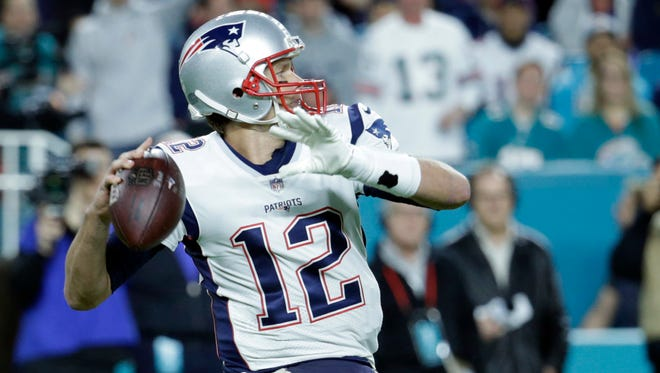 New England Patriots quarterback Tom Brady (12) looks to pass, during the first half of an NFL football game against the Miami Dolphins, Monday, Dec. 11, 2017, in Miami Gardens, Fla.