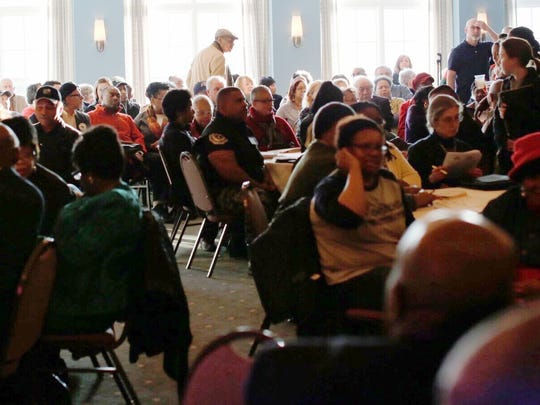People pack the Detroit Golf Club in Detroit for a community meeting about public safety in University District neighborhood on Tuesday.