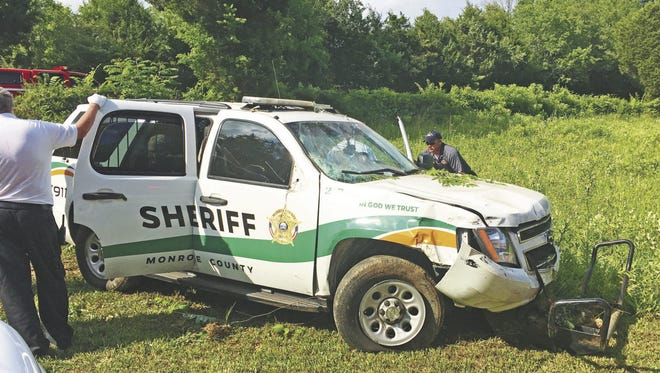 Pictured is the Chevy Tahoe that crashed, injuring Monroe County Sheriff's Office reserve deputy David Greaves and inmate Joshua Roberts.