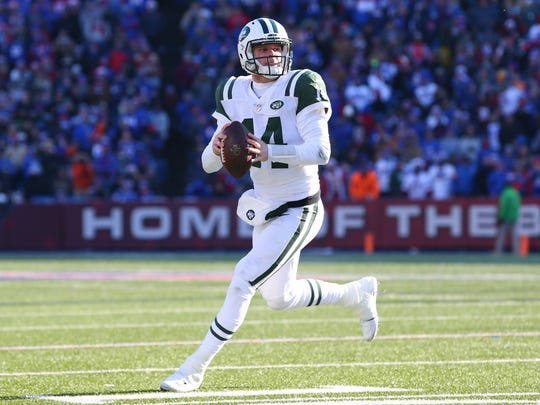 New York Jets quarterback Sam Darnold (14) scrambles out of the pocket against the Buffalo Bills during the second quarter at New Era Field. (Rich Barnes-USA TODAY Sports)