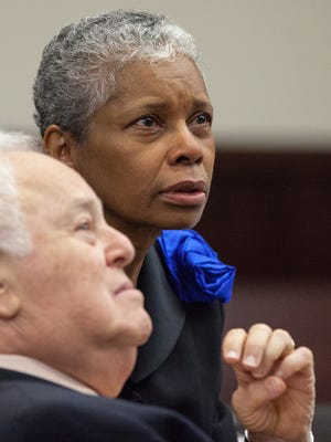 Judge Judith Hawkins, center, and her attorney, Gerald Kogan, left, speak with the opposing attorney during Hawkins's trial before a panel of the Florida Judicial Qualification Commission in Tallahassee on Oct. 7, 2013.   Michael Schwarz/Special to the Democrat Judge Judith Hawkins, center, and her attorney, Gerald Kogan, left, speak with the opposing attorney during Hawkins's trial before a panel of the Florida Judicial Qualification Commission in Tallahassee, Fla on Monday, October 7, 2013.