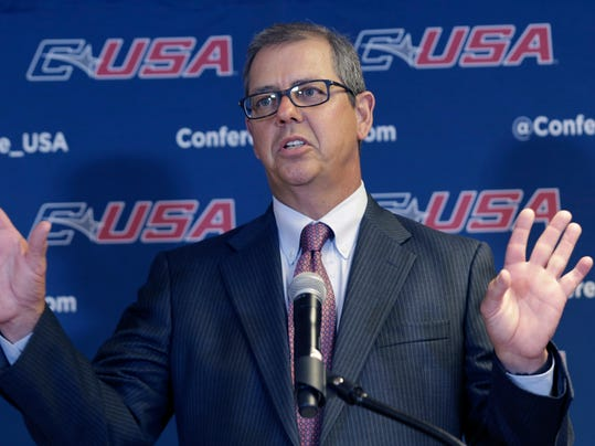 Conference USA commissioner Britton Banowsky speaks at the NCAA college Conference USA football media day in Irving, Texas Wednesday, July 23, 2014.  Banowsky seems to be settling in after a few years of significant change in the makeup of its league, at the same time the five power conferences seem so close to the autonomy they have sought. (AP Photo)