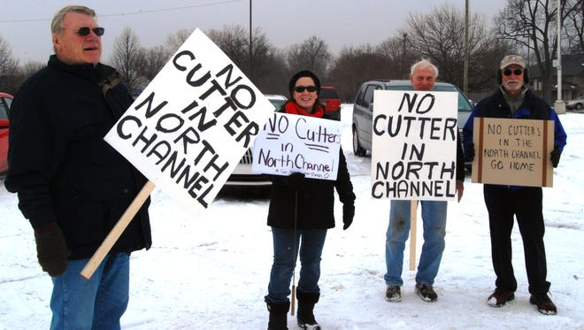 Church Novack, left, Susan Bryson, Tony Skudrna and Mike Balan protest plans by the U.S. Coast Guard to break ice in the North Channel of the St. Clair River.
