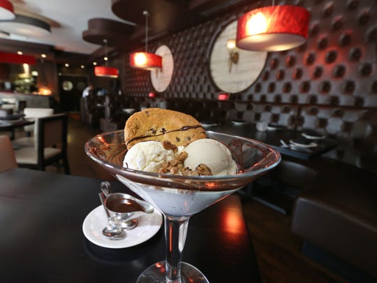 The Las Vegas Birthday Dessert is served up in the main dinning room at City Grill, at 384 East Ave. in Rochester