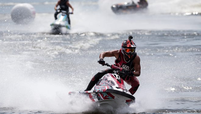 Pro Watercross World Championships racers circle Sugden Lake on Saturday, Sept. 26, 2015, at Sugden Park in East Naples.