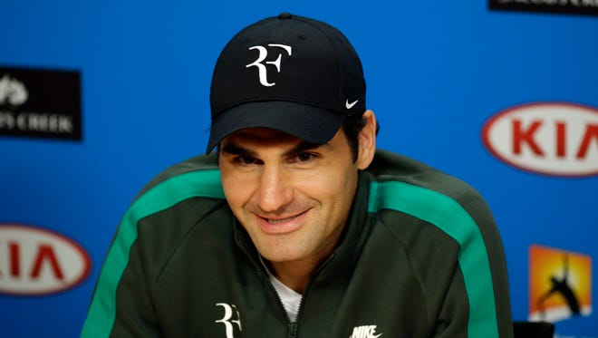 Roger Federer of Switzerland talks to the media during a press conference ahead of the Australian Open tennis tournament at Melbourne Park.