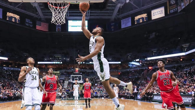 Bucks forward Jabari Parker goes up for a layup Thursday night as Milwaukee's Giannis Antetokounmpo and Bulls defenders Rajon Rondo (left) and Jimmy Butler (right) look on during Milwaukee's victory over Chicago at the BMO Harris Bradley Center.