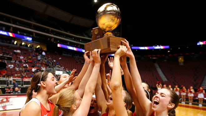 The Seton Catholic girls basketball team celebrates after winning the 2017 4A state championship at Gila River Arena in Glendale.