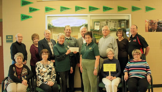 Patsy (Shean) Summers presents endowment check to Principal Eric Ramsey. Also featured: Barry Johnson, Ed and Marie (Harris) Hewlett, John Parker, Carl Presley, Toni (Hickman) Wieland, Jan (Steury) Hale, Linda (Wiggins) Likins, Suzanne (Scroggs) Boyts, Jane Bennett, Judith (Gregory) Parker, and Gene Summers.