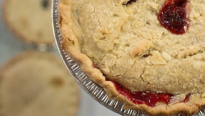 A cherry pie sits on top of the case at Myers Salads and Pastries in York's Central Market.